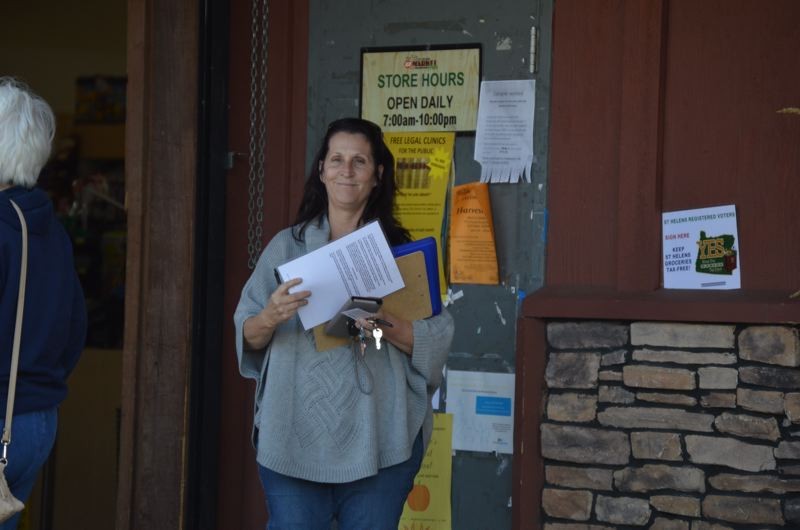 SPOTLIGHT PHOTO: NICOLE THILL - Susan Mays, a paid signature-gatherer, was collecting signatures oustide of St. Helens Market Fresh on Tuesday afternoon, Oct. 24. Petitioners are aiming to get 1,500 verfied signatures on the initiative before filing it with the Columbia County Elections Office.
