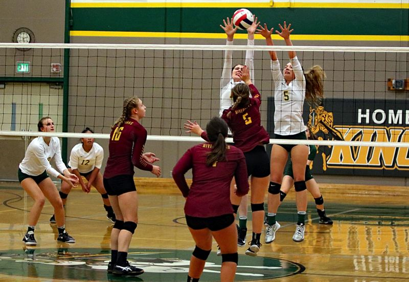 REVIEW/NEWS PHOTO: JIM BESEDA - Putnam's Emma Whittington and Kristen Hale put up some solid defense in the opening set of Tuesday's OSAA Class 5A volleyball play-in game against The Dalles. Putnam won in four sets.