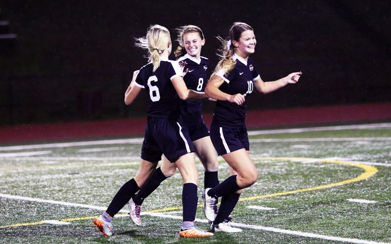 DAN BROOD - Sherwood seniors (from left) Lauren Scarvie, Maddie Kilcoin and Ashleyn Strohmaier celebrate following the Lady Bowmen's win at Tualatin.