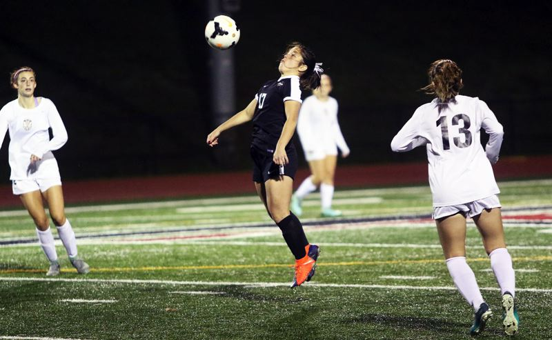 DAN BROOD - Sherwood junior Gillian Pedan tries to control the ball during the match at Tualatin.