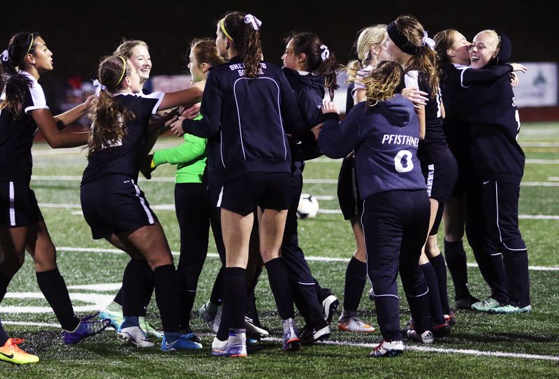 DAN BROOD - The Sherwood girls soccer team celebrates following the 3-2 win at Tualatin.