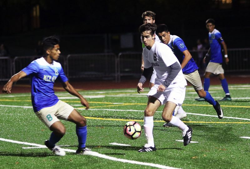 DAN BROOD - Sherwood senior Leonardo Simoes Del Buono looks to get the ball up field during the Bowmen's state play-in win over McKay.