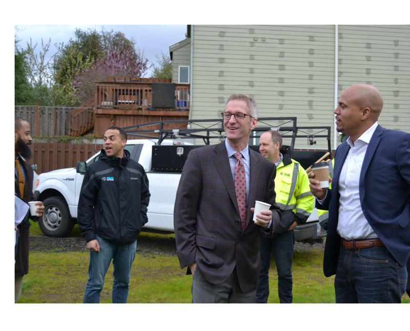 PAMPLIN MEDIA GROUP: FILE PHOTO - Mayor Ted Wheeler and Andrew Colas, president of Colas Construction, chat it up at the Beatrice Morrow Groundbreaking last Spring. Colas, a certified minority-owned firm, recently won the Oregon Convention Center renovation contract.