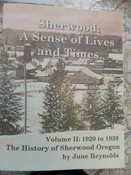 GAZETTE PHOTO: RAY PITZ - June Reynolds new book, Sherwood: A Sense of Lives and Times, Volume II: 1920 to 1939, The History of Sherwood, Oregon, is available at the Sherwood Historical Society, 22552 S.W. Park St. Its open Wednesdays and Saturdays from 1 to 4 p.m.