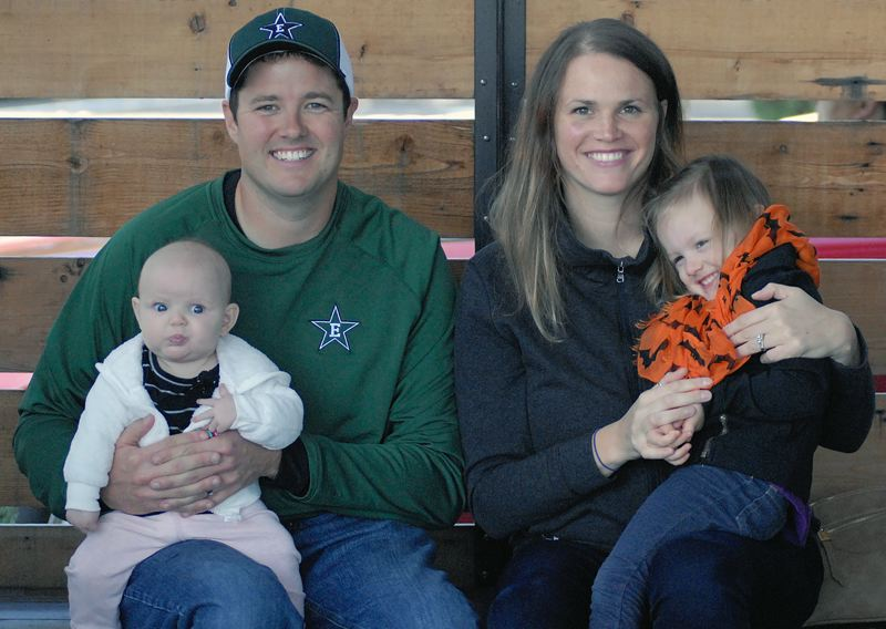 OUTLOOK PHOTO: MATT RAWLINGS - Andy and Jessie Mott juggle busy coaching jobs while raising their two daughters Keenie and Millie.