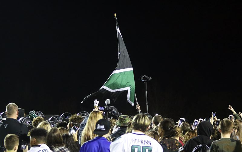 DAN BROOD - The Tigard players and fans celebrate on the field at Tualatin High School following the end of Friday's game.