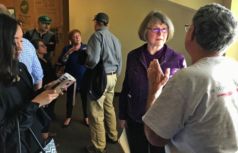 TIMES PHOTO: DANA HAYNES - Rep. Margaret Doherty (lat left in blue) and Sen. Ginny Burdick, forground, take questions from constituents at Symposium Coffee in Tigard.