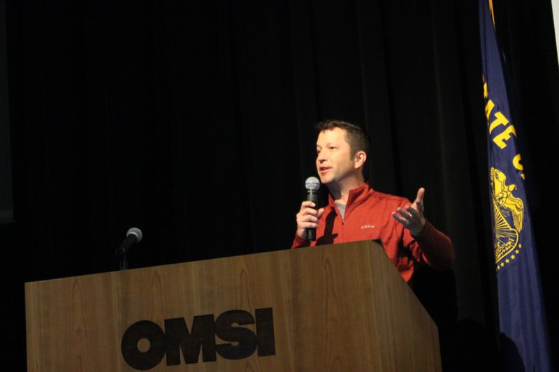 TRIBUNE PHOTO: LYNDSEY HEWITT - Mark Nelsen, a meterologist at KPTV presented the weather year in review at OMSI on Saturday.