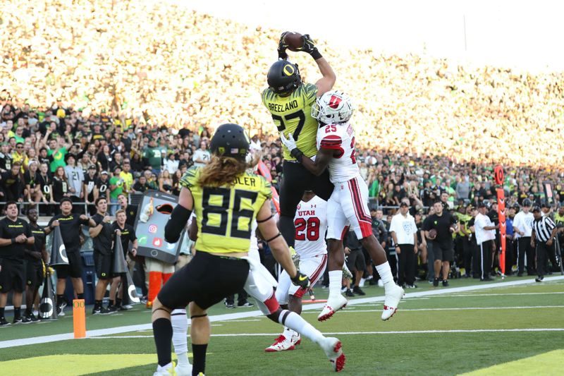TRIBUNE PHOTO: JAIME VALDEZ - University of Oregon tight end Jacob Breeland goes up for a touchdown catch against Casey Hughes of Utah.