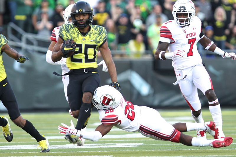 TRIBUNE PHOTO: JAIME VALDEZ - Oregon Ducks running back Tony Brooks-James  avoids being tackled by Utah Utes defensive back Javelin Guidry in the second half at Autzen Stadium.