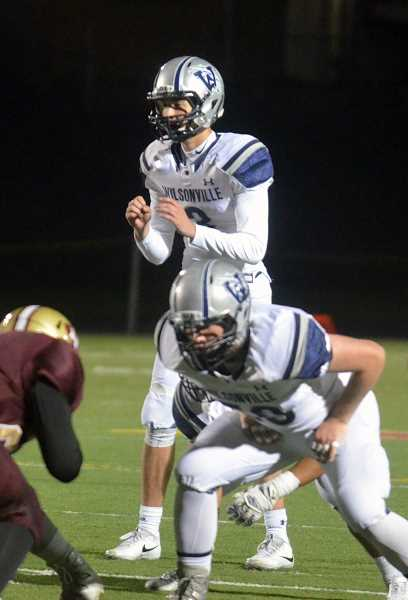 SPOKESMAN PHOTO: TANNER RUSS - Junior quarterback Nathan Overholt connected with senior wide receiver Jacob Herr for the nights first touchdown. Overholt threw for 191 yards on Friday Oct. 27.