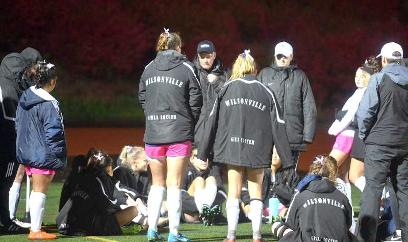 SPOKESMAN PHOTO: TANNER RUSS - Dwight Sheppick and his coaching staff talk to the girls after a game. The Wildcats lost their match against the Ridgeview Ravens 1-0 on Friday Oct. 27.