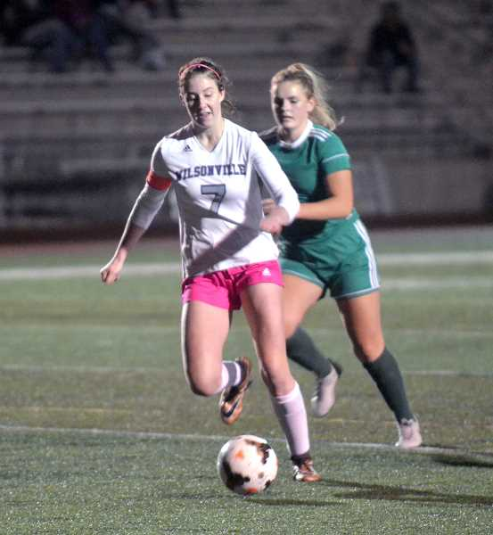 SPOKESMAN PHOTO: TANNER RUSS - Junior Teagan McNamee moves the ball downfield to attack the goal. The Wildcats lost their match against the Ridgeview Ravens 1-0 on Friday Oct. 27.
