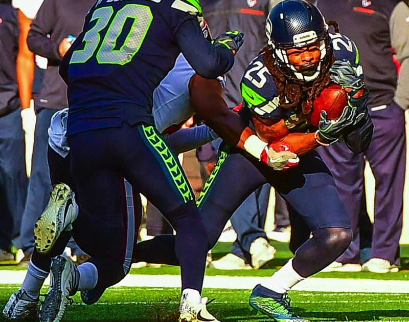 MICHAEL WORKMAN PHOTO - Richard Sherman returns an interception for the Seahawks.