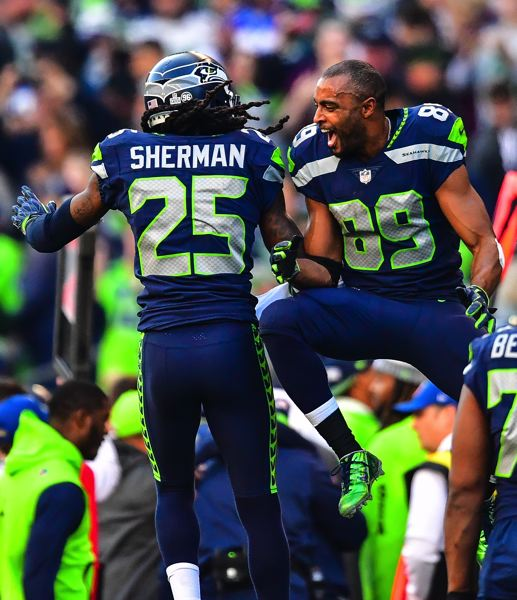 MICHAEL WORKMAN PHOTO - Receiver Doug Baldwin (right) greets defensive back Richard Sherman on the Seattle sideline.
