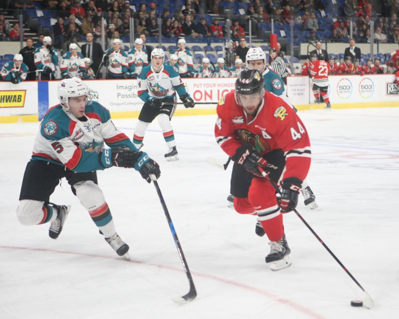 COURTESY: GARY PETERSON/PORTLAND WINTERHAWKS - A three-game losing streak has Portland Winterhawks captain Keoni Texeira (right) saying the team needs to recapture its work ethic.