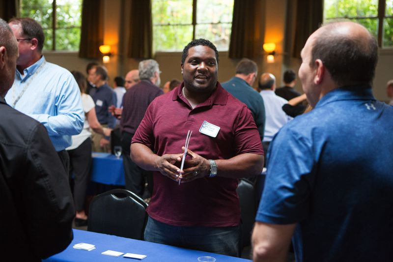 PAMPLIN MEDIA GROUP: ADAM WICKHAM  - Johnny Metoyer, Portland Public Schools Construction Manager, talks to subcontractors at the Growing Portland open house at the McMenamins Kennedy School.