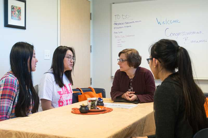 HILLSBORO TRIBUNE PHOTO: CHRISTOPHER OERTELL - Congresswoman Suzanne Bonamici listens to Student Health Advisory Committee members, Anne Nguyen, 16, Jenny Nguyen, 17, and Tina Tep, 17, at the Century High School-Based Health Center in Hillsboro