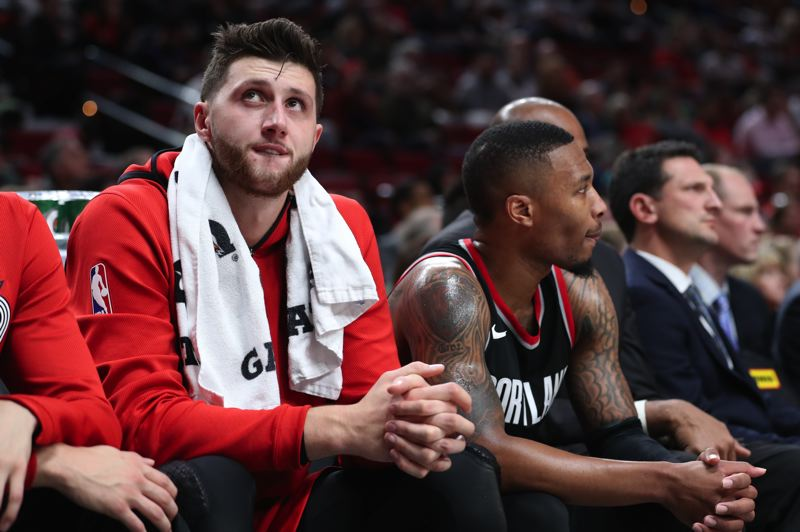 TRIBUNE PHOTO: JAIME VALDEZ - Trail Blazers players Jusuf Nurkic and Damian Lillard watch the proceedings as Portland falls to Toronto at Moda Center.