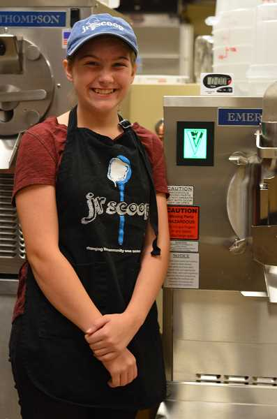 SPOKESMAN PHOTO: CLARA HOWELL - Eighth-grader Halle poses next to Junior Scoop's new ice cream maker, purchased last year.