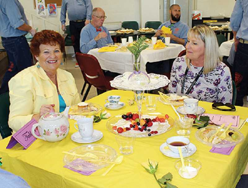HOLLY M. GILL - Pat Watson, who helped organize the event, and Cheryl Britton, office manager for COCC at DRCI, attend the tea.