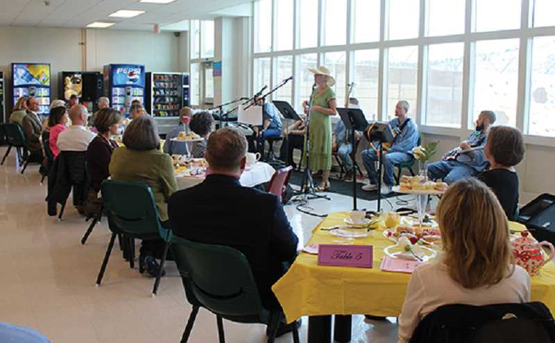 HOLLY M. GILL - Janet Narum (in hat), Central Oregon Community College education director for DRCI, introduces participants at the Oct. 25 'high tea' at Deer Ridge Correctional Institution. More than 40 community members attended the event, designed to encourage people to volunteer at the prison.