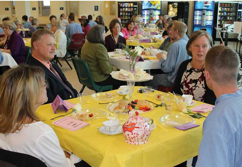 HOLLY M. GILL - Clockwise from left, Coralee Popp, the director of Art Adventure Gallery, DRCI Superintendent Tim Causey, and COCC Vice President of Instruction Betsy Julian sit with an inmate at DRCI's 'High Tea' Oct. 25, at the prison.