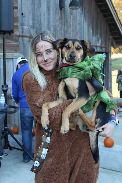 SPOKESMAN PHOTO: CLAIRE GREEN - Wilsonville Parks and Recreation Coordinator Erica Behler and her 1-year-old pooch, Tahlia, got into the festive mood at the Wilsonville Harvest Festival Oct. 28.