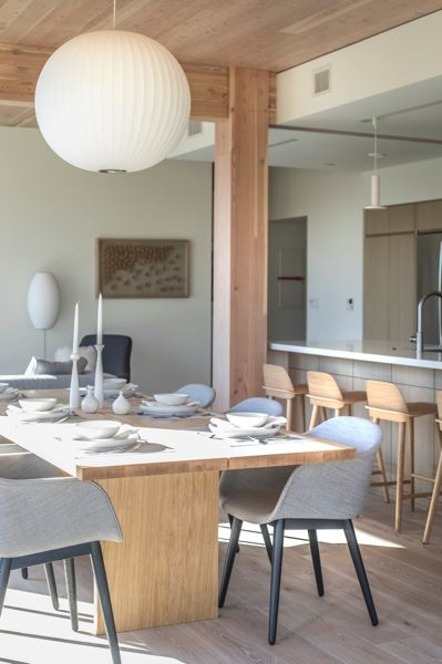 PAMPLIN MEDIA GROUP: JONATHAN HOUSE - The dining room and kitchen of a new condo at the new wooden Carbon12 building in North Portland.