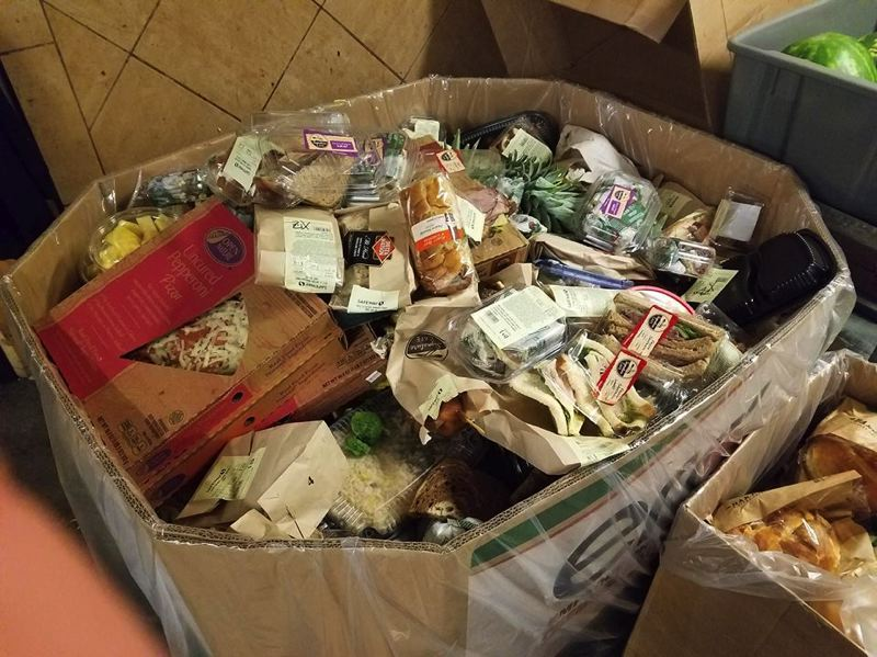 COURTESY: SUSIE SNORTUM - A bulging cardboard box shows the enormous amount of edible food that would have been thrown away by a downtown grocery store. An employee contacted Waste Not Food Taxi to have it picked up and donated instead.