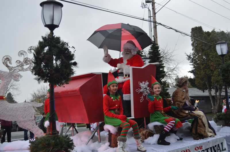 GAZETTE FILE PHOTO - Santa Claus wave to children during the Robin Hood Festival Associations annual Winter Festival and Tree Lighting, set for Dec. 2.