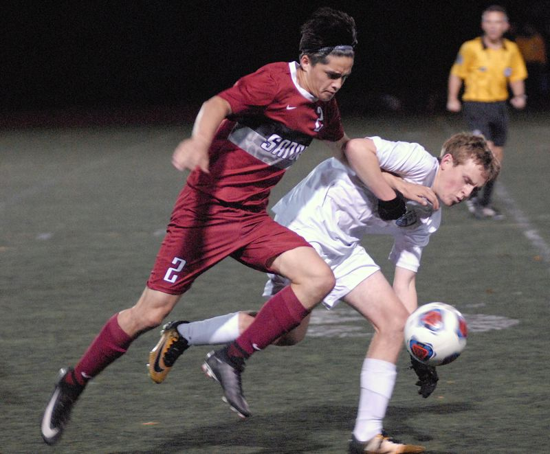SANDY POST: MATT RAWLINGS - Sandy's Anthony Ruiz (left) battles with a Corvallis defender for possession of the ball.