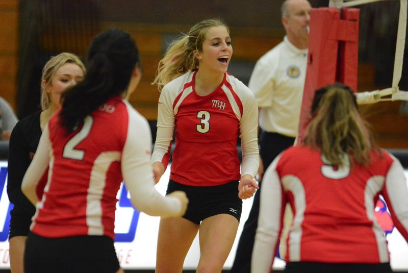OUTLOOK PHOTO: DAVID BALL - Mt. Hoods Hannah Spears celebrates after one of her nine kills during Wednesdays road sweep at Clackamas.