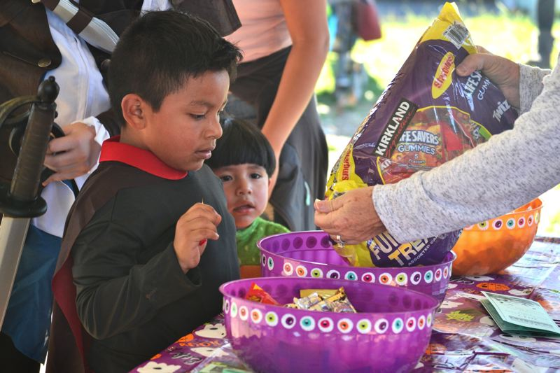 POST PHOTO: BRITTANY ALLEN - John L. Scott staff kept the candy flowing at the AntFarm Outdoor Building space during the 2017 Trick or Treat Trail.