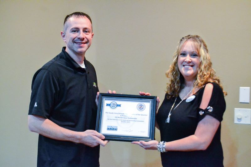 POST PHOTO: BRITTANY ALLEN - Master Sam Lider of U.S. World Class Taekwondo was presented with the Sandy Area Sensational Business Award at the Oct. 25 Sandy Area Chamber of Commerce Luncheon.