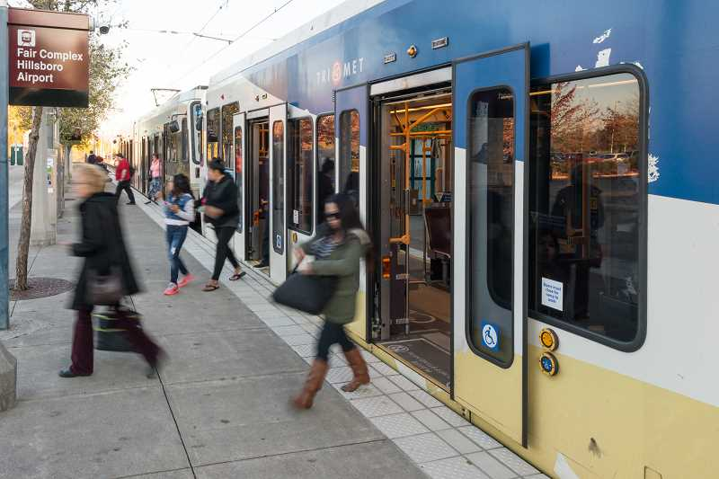 HILLSBORO TRIBUNE FILE PHOTO - Red Line expansion would mean riders could take a single train from Hillsboro at the fair complex to Portland International Airport. The trip currently requires changing trains.