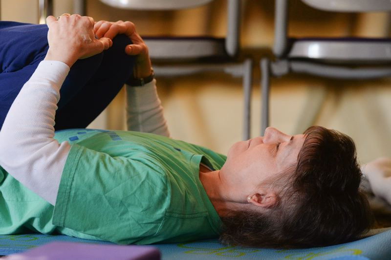 OUTLOOK PHOTO: JOSH KULLA - Debbie Noonan, who is living with a brain tumor, has survived for eight years longer than doctors predicted and has been coming to the Legacy yoga class since it started.