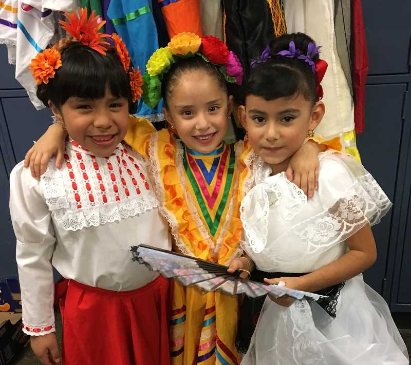 CONTRIBUTED PHOTO - Folklórico dancers take a break after performing Wednesday, Nov. 1.