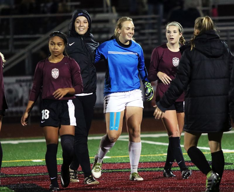 DAN BROOD - The Tualatin girls soccer team is all smiles following the 4-2 playoff win at Sherwood.