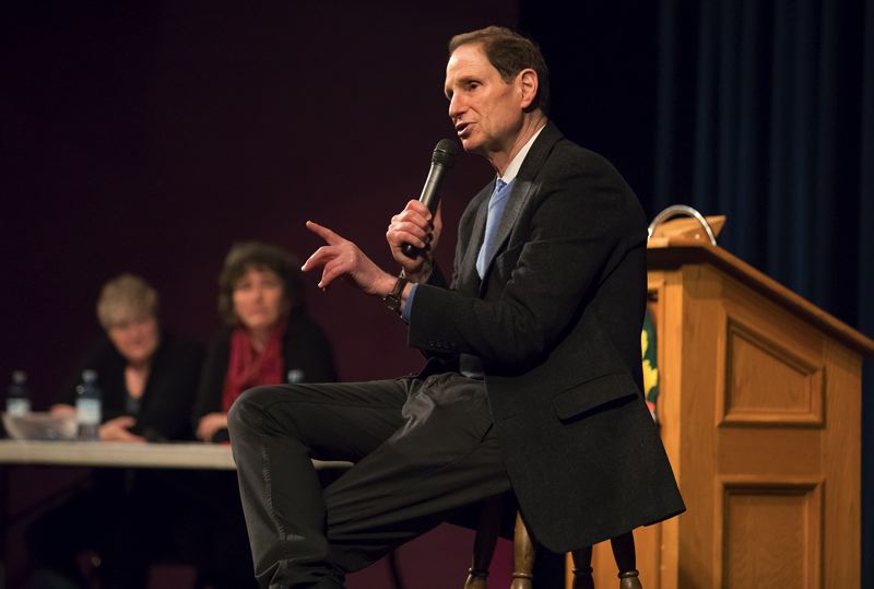 TIMES PHOTO: JONATHAN HOUSE - U.S. Sen. Ron Wyden speaks at a town hall meeting Friday afternoon at Tigard High School.