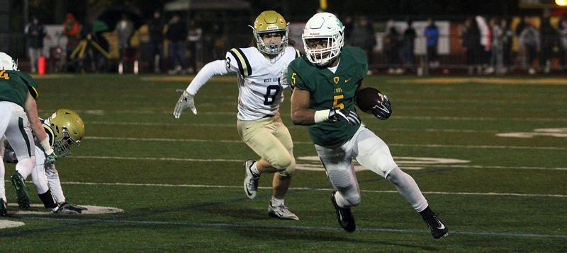 TIDINGS PHOTO: MILES VANCE - West Linn's Ahmir McGee finds running room during his team's 63-13 home win over West Albany in the first round of the Class 6A state playoffs on Friday.