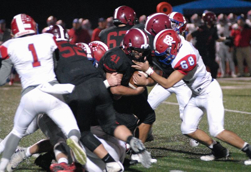SANDY POST: MATT RAWLINGS - Sandy's Iosefa Polamalu bulls through a pile of Lebanon tacklers.