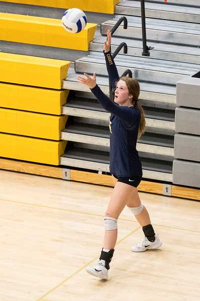 LON AUSTIN/CENTRAL OREGONIAN - Raegan Wilkins served the final eight points of the match as the Crook County Cowgirls came from behind in the fourth set to defeat Cottage Grove, claiming fourth place at the state tournament.