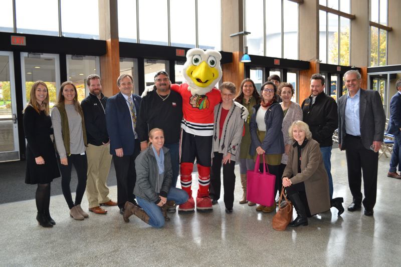 COURTESY PORTLAND WINTERHAWKS - At the Veterans Memorial Coliseum on Friday, Nov. 3. The design and construction team including employees from:Blazers, Winterhawks, Rose Quarter Management, City of Portland Office of Finance and Management, R&H Construction (the Refresh contractors), The Wenaha Group (the Refresh project managers), and Merryman Barnes Architects (the Refresh architects). Architect Stuart Emmons, co-chair of Friends of the Memorial Coliseum, is on the right.