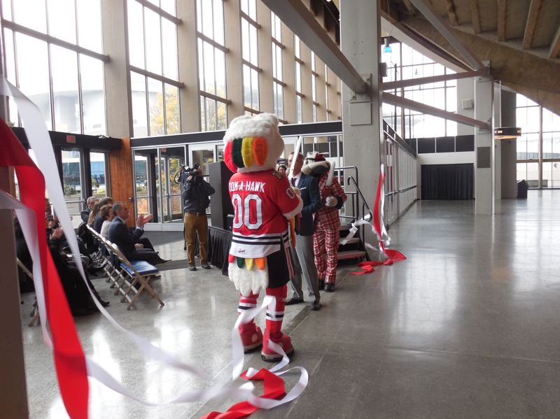 PAMPLIN MEDIA GROUP: JOSEPH GALLIVAN  - Mayor Ted Wheeler with the Winterhawks and Trail Blazers mascots having just cut the ribbon on the refresh of the Veterans Memorial Coliseum.