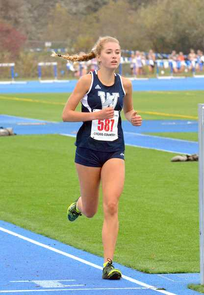 SPOKESMAN PHOTO: TANNER RUSS - Sophomore Samantha Prusse took 15th place overall in the state meet at Lane Community College on Nov. 4.