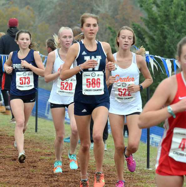 SPOKESMAN PHOTO: TANNER RUSS - The Wilsonville girls team took sixth place overall at the state cross country meet in Eugene on Nov. 4.