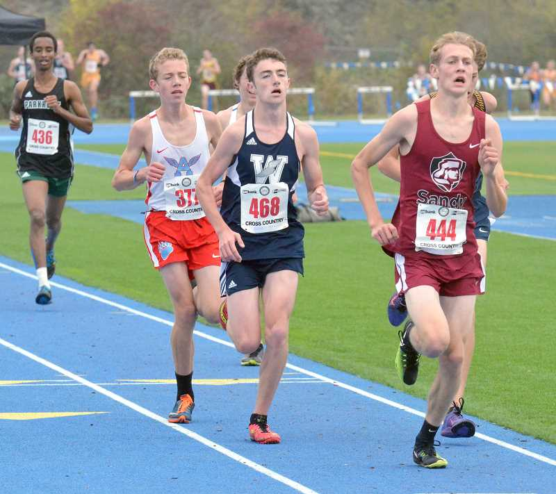 SPOKESMAN PHOTO: TANNER RUSS - Senior Nicholas Whitaker in the final 200 meters of the race. Whitaker took 31st overall on Nov. 4 at the state meet.