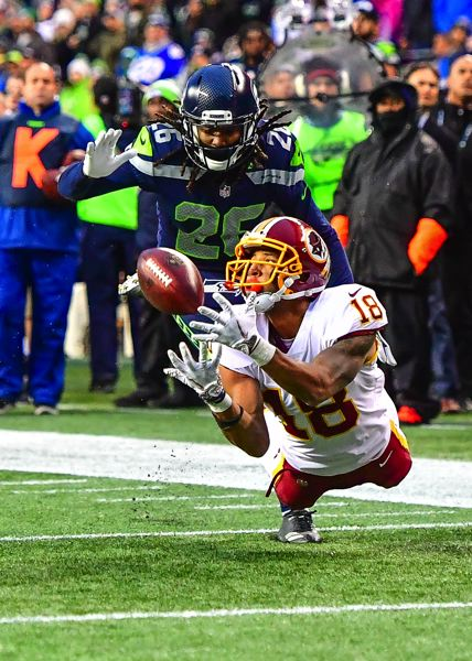 MICHAEL WORKMAN PHOTO - Josh Doctson of the Washington Redskins reaches for the reception to the 1-yard line that sets up the winning touchdown against defender Shaquill Griffin and the Seattle Seahawks.