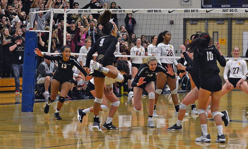 TIMES PHOTO: MATT SINGLEDECKER - The Southridge volleyball team beat Central Catholic in the Class 6A state championship game on Saturday for its first state title in school history.
